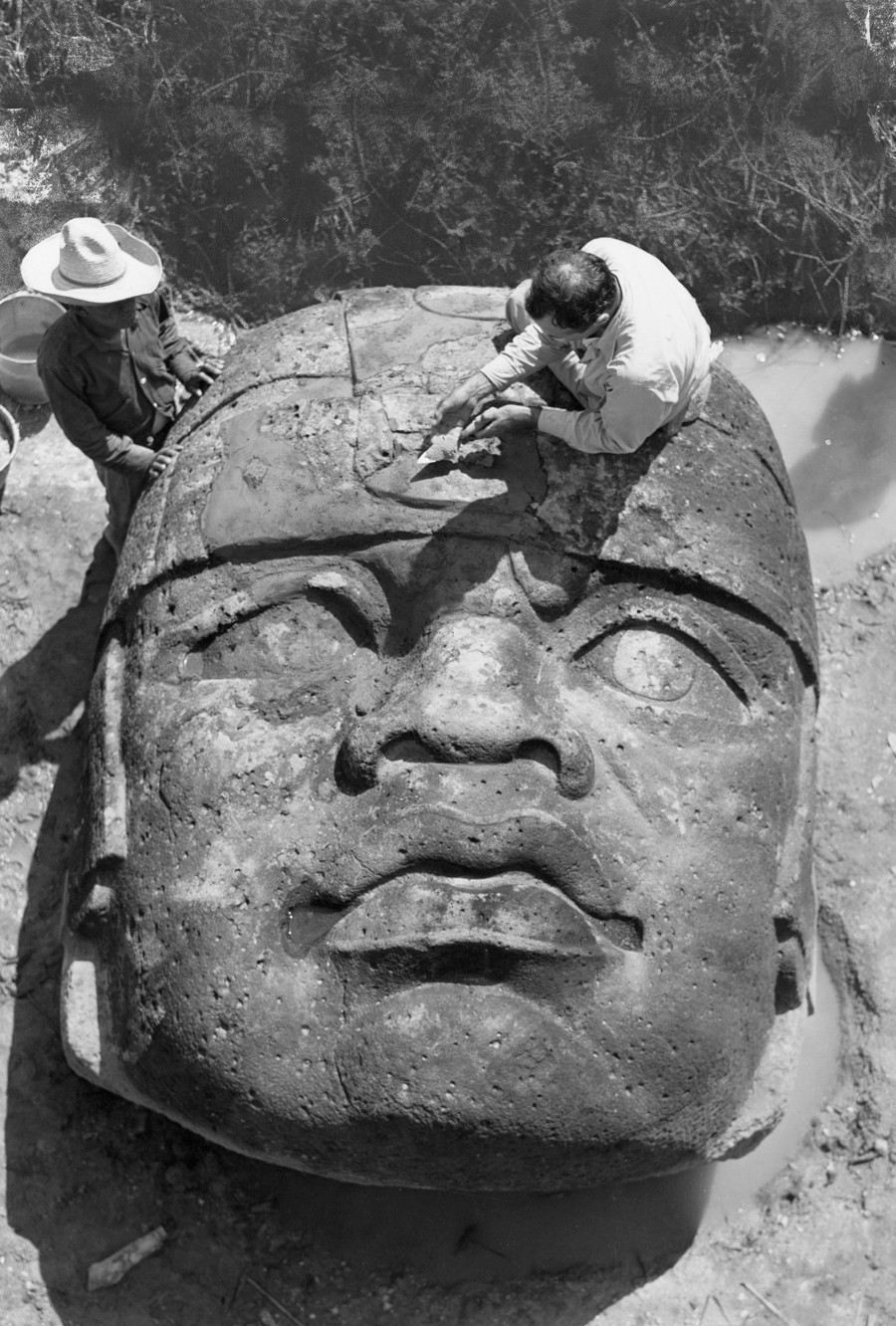 natgeofound :     A giant Olmec head discovered in 1946 gets a patch, San Lorenzo, Mexico.  Photograph by Richard Hewitt Stewart, National Geographic