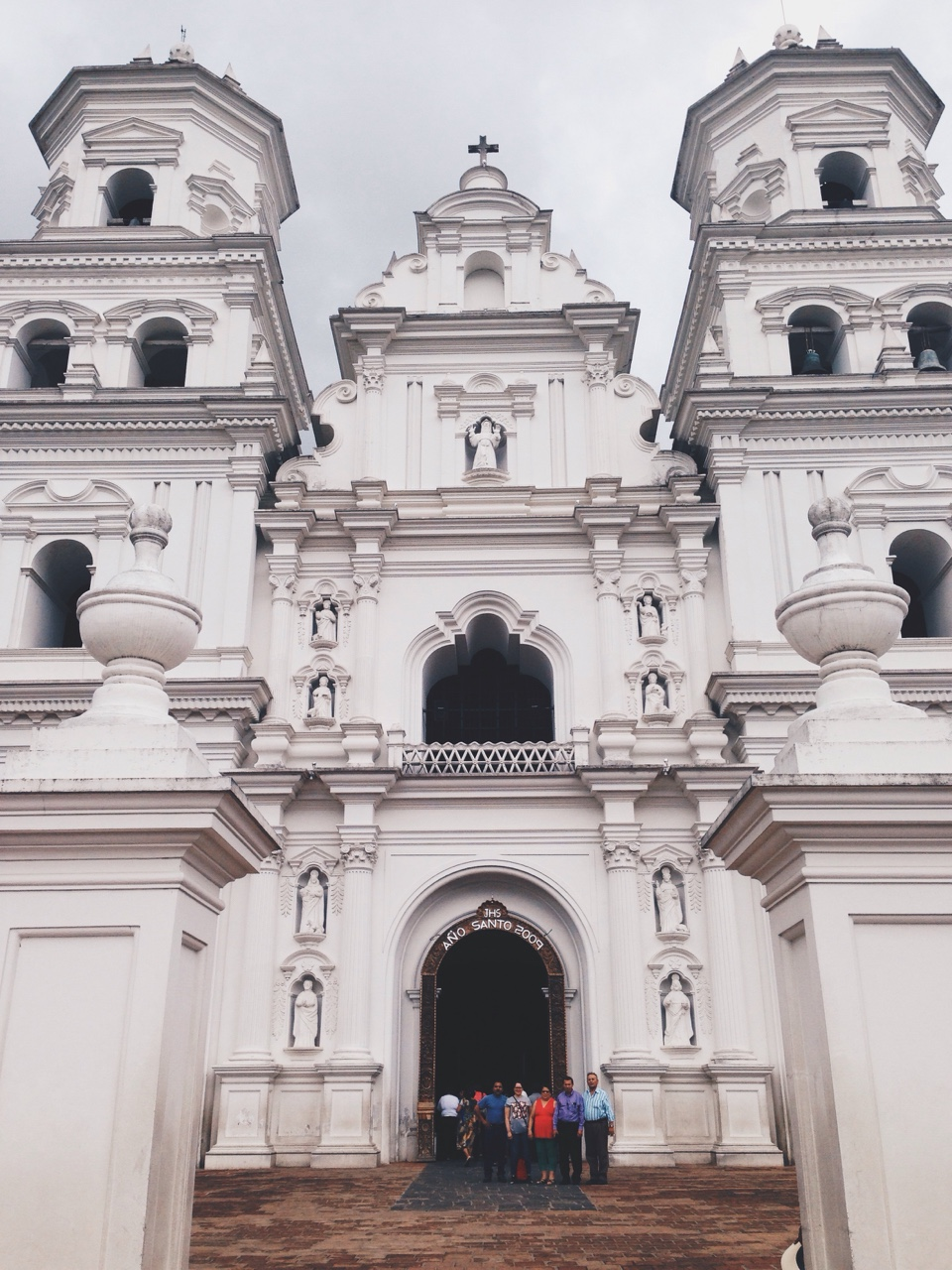 """Por más de 400 años, la Basilica de Esquipulas, Guatemala ha visto miles de milagros y generaciones de mi familia pasar por sus puertas. El milagro más grande que mi pequeña alma de 29 años ha sentido fue la calma brisita de mis antecedentes saludándome, """"Bienvenidos, Yita.""""   For over 400 years, the Cathedral of Esquipulas, Guatemala has seen thousands of miracles and generations of my family pass through its' doors. The biggest miracle that my small 29 year old soul has witnessed was the small zephyr of my ancestors whispering, """"Welcome, Yita""""."""
