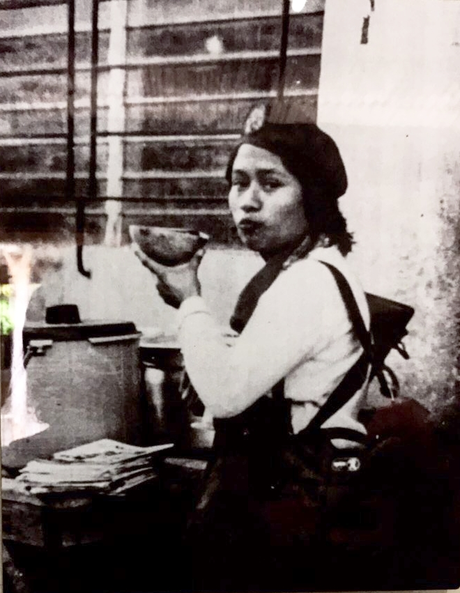 Guerrillera drinking from a huacal (bowl).