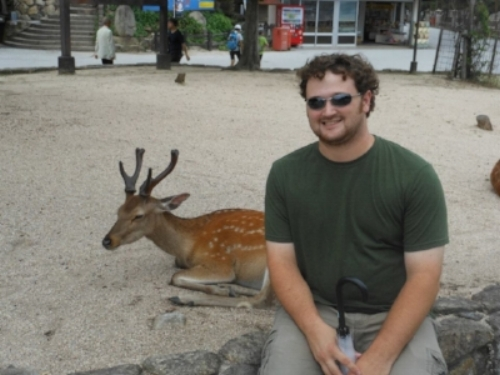 Adam and a deer in Miyajima, Japan