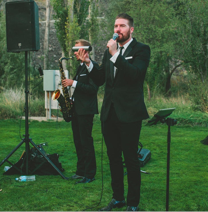 "Conn and Rob Perform Jack Johnson's ""Better Together"" during the wedding ceremony."