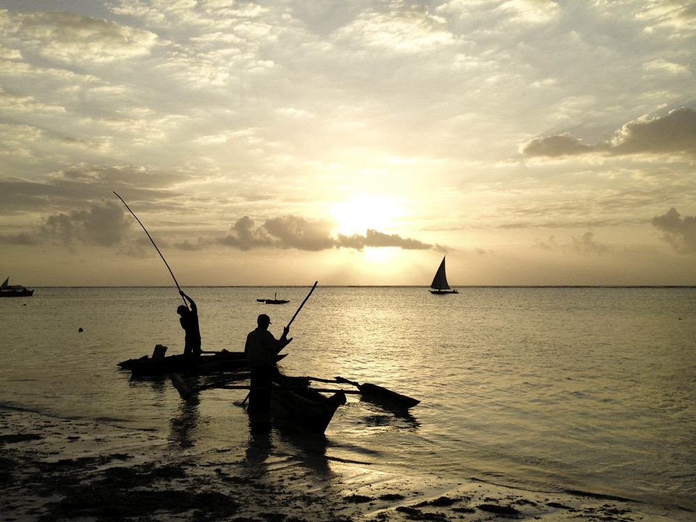 Sunrise, Zanzibar.  Fisherman head out to sea in the morning for the days catch.