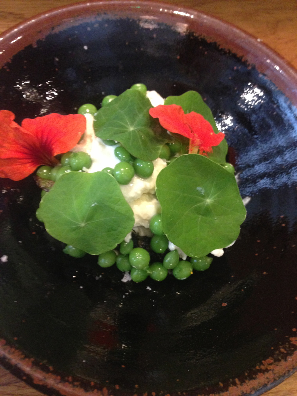 A bowl of soft tofu, peas and nasturtiums at Koya Bar, Soho. Health and pleasure combined.