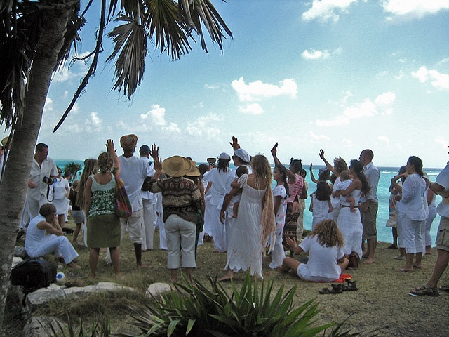 A convergence of spiritual revelers celebrating the Spring Equinox on a beach near Tulum, Mexico.