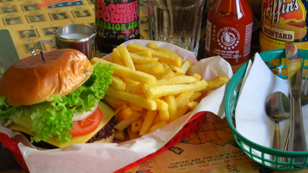 "A 100% vegan burger, served with vegan fries - - ->  Goes great with Schoppe Bräu's ""Flower Power"" IPA. And now we have mini bottles of ""Flying Goose Brand"" sriracha on every table, which is also vegan, and is a great way to spice up whatever burger you might order."