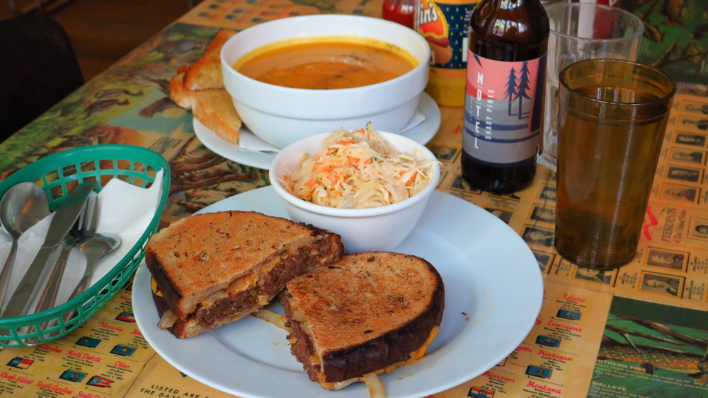 "A bowl of this week's soup together with this week's sandwich.  Try them with one of our great craft beers!  Just in is the ""Sandy Pines"" I.P.A. from Motel Beer.  Strong but very crisp and  drinkable even at 6.6% alcohol content, and extremely multli-layered in hoppy flavor...a beer for real beer geeks, made with ""experimental"" hops from Slovenia!"