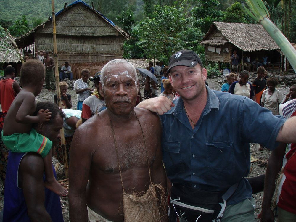 Exploration Manager Jason Ward (right) with a local community member.