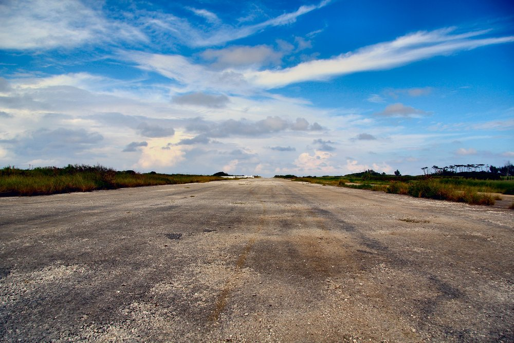 The abandoned US runway that now links the north and south of the island. Imagine a P38, a Corsair, a B25 rolling down here, because they did. I didn't use it to rev out my Nissan Cube. Honest. Pitty I left the Hayabusa at home.