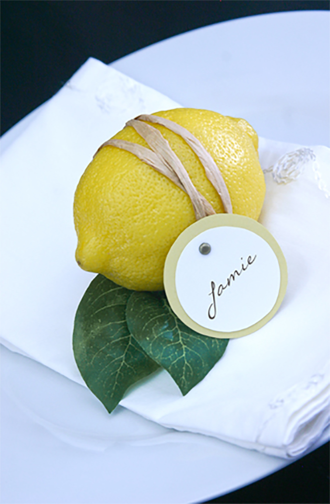 Photo:  Something Turquoise    Place settings are not a requirement - but they can be so much fun to make and get creative with! I love this simple place setting using a fresh lemon, rubber band and a small tag. Simple, colorful, and it can be used to flavor your tea (or cocktail) later! You could also write on a small tile (such as subway tiles from the hardware store) or a simple white card is always classic.