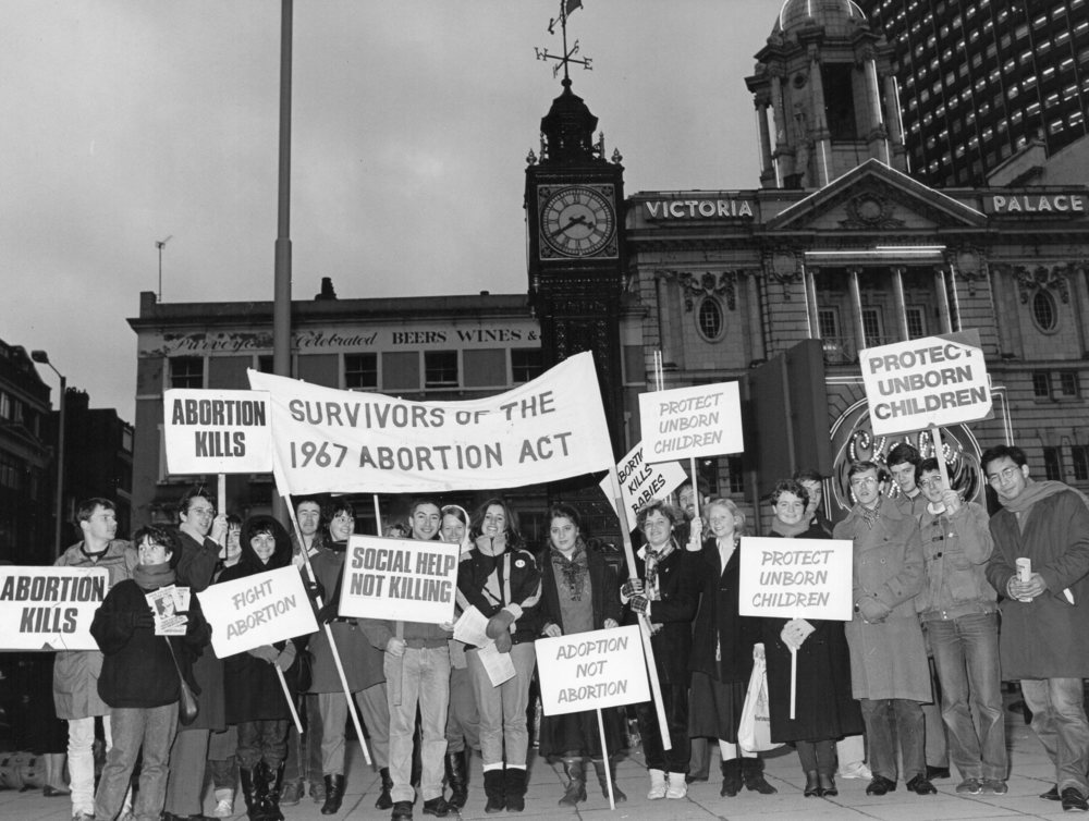 The youth and students division of the Society for the Protection of   Unborn Children holds an all-night vigil between the Victoria Palace   Theatre and Victoria Station in 1986 to protest against 18 years of   legalised abortion (since 27th April, 1968)