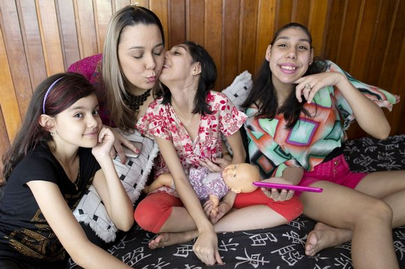 Viviane Lima and her daughters. Source: The Times