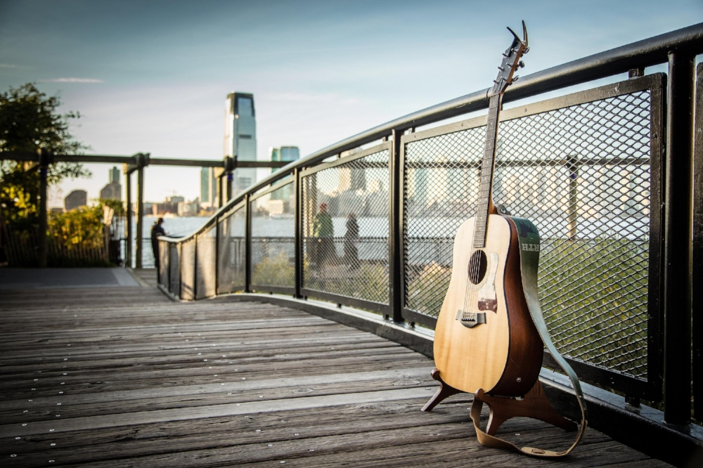 We met up a few days beforehand to scout locations and finally decided on a small bridge right on the water in Battery Park City. On the day of, I arrived a few minutes early, hid, and waited. As they walked up, saw the guitar, and Robbie started to sing, Ellie knew exactly what was happening.