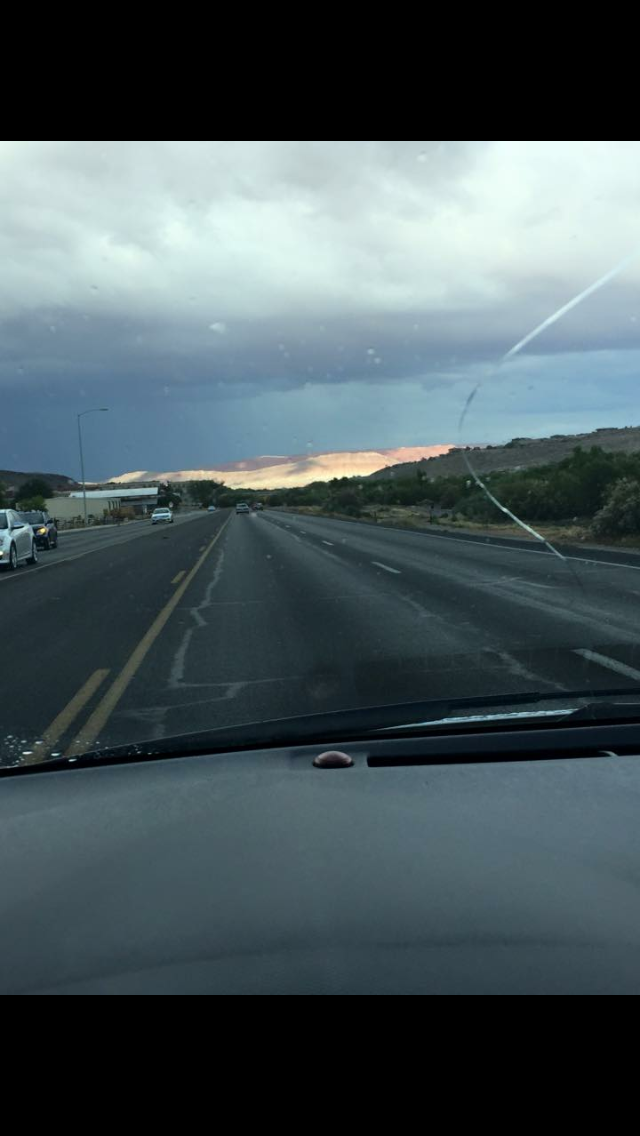 Rain clouds everywhere, except over Little Valley where Kycie was being welcomed home. (picture sent to us from someone in St. George.)