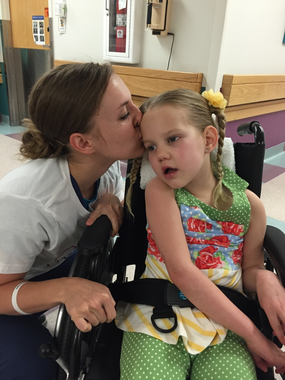 She can get in trouble for kissing her patient, but this little Courtney was life saver.  I love this picture of her kissing Kycie goodbye.