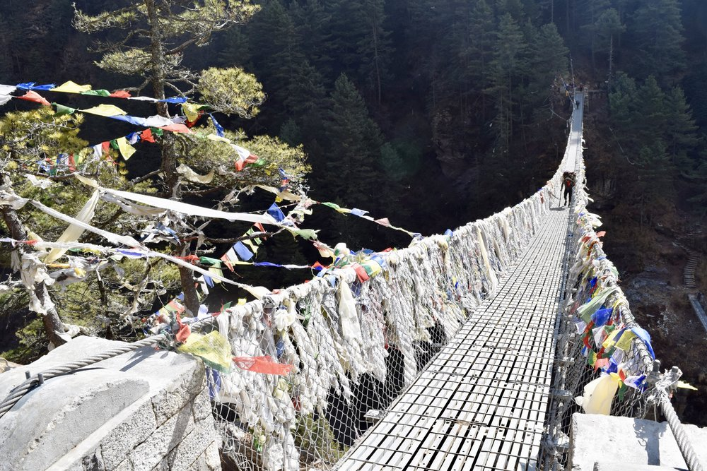 Suspension bridge with prayer flags on the way to Namche