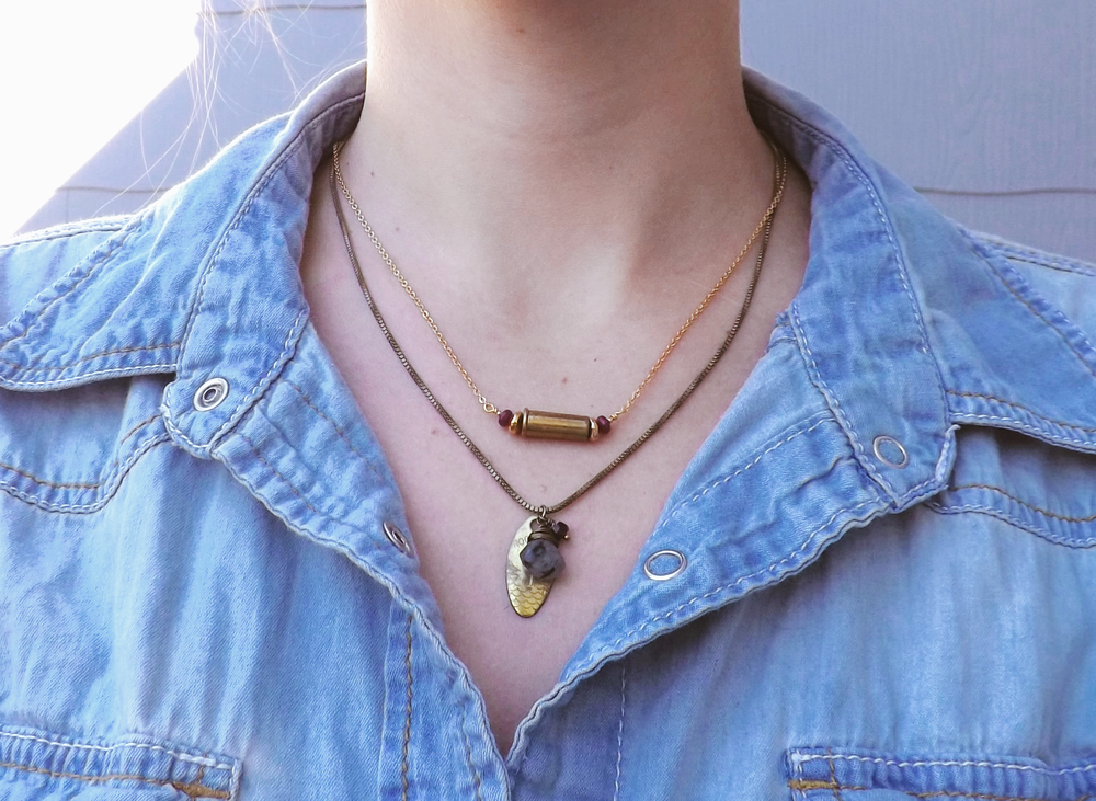Our Fiercely Loved bullet shell necklace & Vintage Charm Necklace look great as layering necklaces with a chambray shirt.