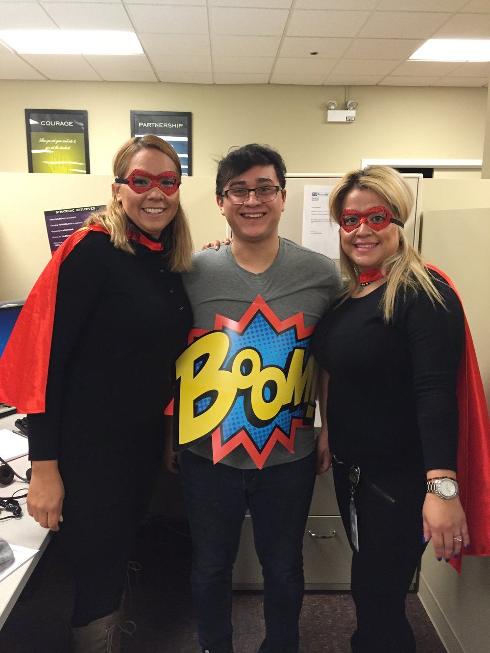 A few members of the customer service team donning their superhero garb for their parade day