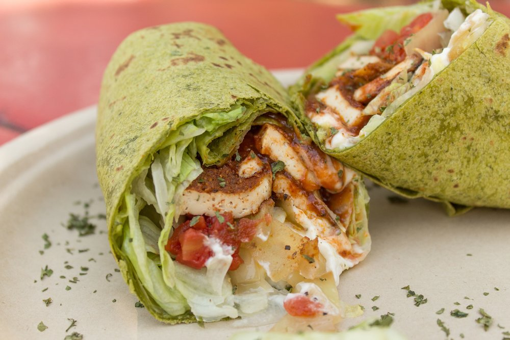 Blackened tofu wrap on a spinach tortilla