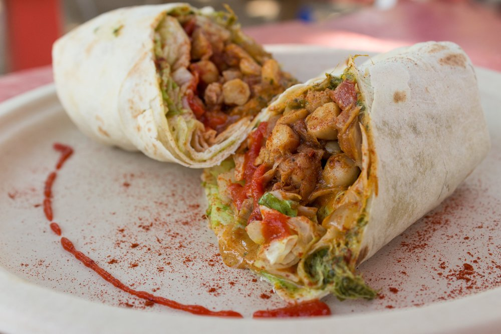 Our most popular item: the Indian-style spicy chickpea wrap. Pictured on a flour tortilla
