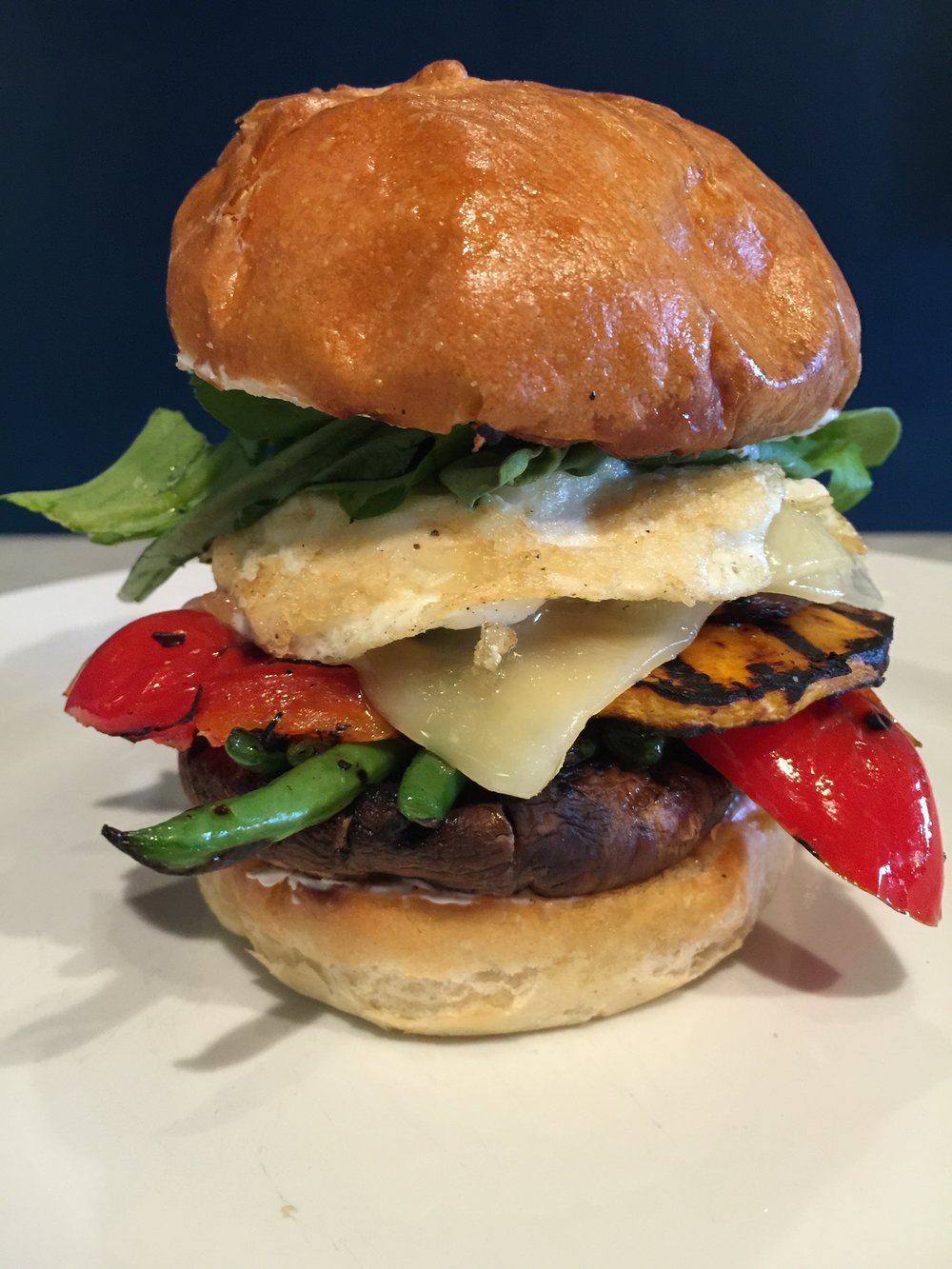 Grilled vegetable sandwich, brioche bun, white cheddar.