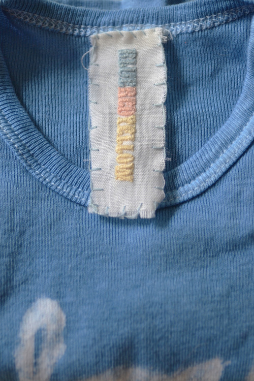(Hand dyed piece and their signature tag made with hand dyed thread)