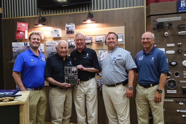 Rogers Caldwell accepting his award from Bill Huntley, Founder of T-H Marine