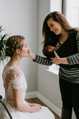 Jocelyn & Baby J. doing Meredith's makeup. Photo by Emily Tebbetts Photography.