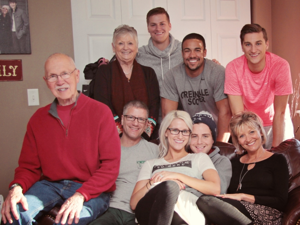My fam from top to bottom, left to right:  My brother Tyler, my Grandma Sue, my brother Elliot, my brother Chad, my Grandpa George, my daddy Gregg, myself, my hubby Caleb, and my mama Tammy.