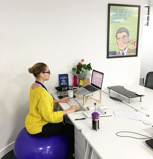 My current setup at work 😇 (Standing desk coming soon) The idea of sitting on the ball versus a traditional chair is that this change can increase core strength, since the abdominal muscles must be constantly engaged to avoid falling off. 🙅🏼 Improving core strength means improving posture, balance, and stability. Plus who does not want to burn extra calories? 😇 #healthybody #health #balance #atwork #business #businesswoman #workhard #instacool #instagood #instadaily #instadaily #justdoit #weightloss #burncalories #vegan #dreambig #inspire #inspireothers #change #changeyourlife #work #technology #innovation #lovewhatyoudo #like #london #londonlife #mylife #neverstopimproving #coreworkout #core
