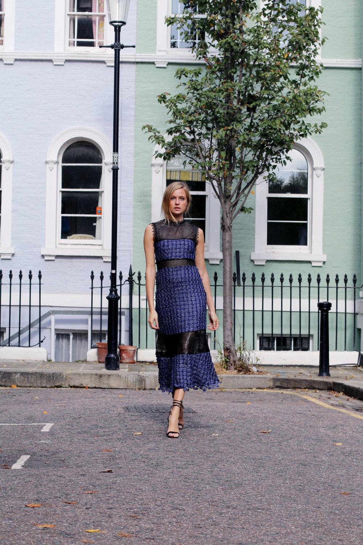 Annabell is wearing a Self-Portrait Ava dress in Black/Blue