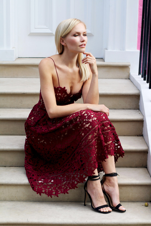 Sara is wearing a Self-Portrait Azeala dress in Burgundy