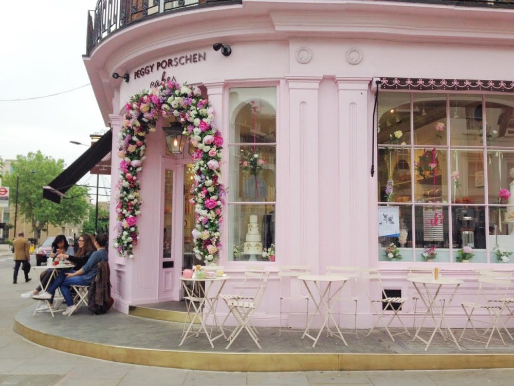 The floral door we were talking about.. Unfortunately it's gone for the winter months, so we had to look for a picture online to show you just how pretty it was during summer.. :) -photo from Pinterest