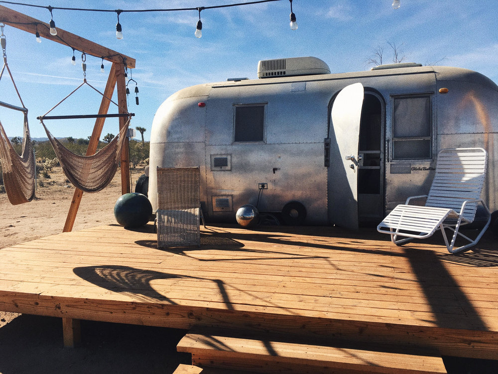 The smallest airstream on the property and its lovely patio with Hammocks and sunbeds