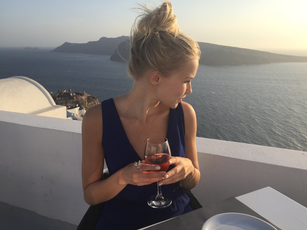 Having dinner whilst watching the Santorini sun set - I will totally be going back here!