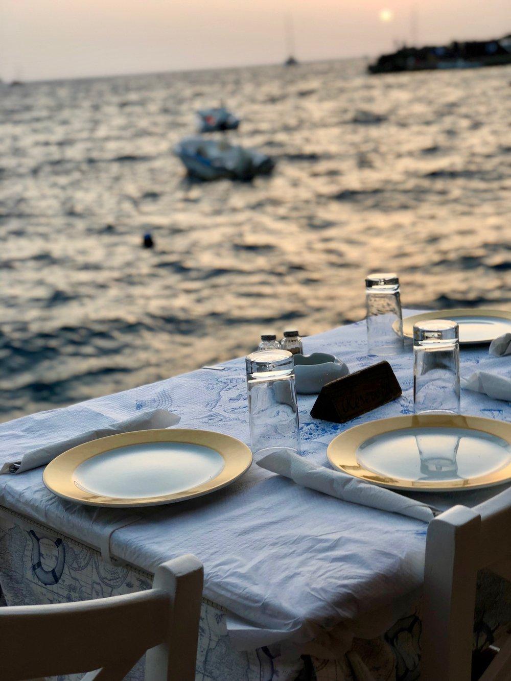 Sunset dinner in Amoudi Bay