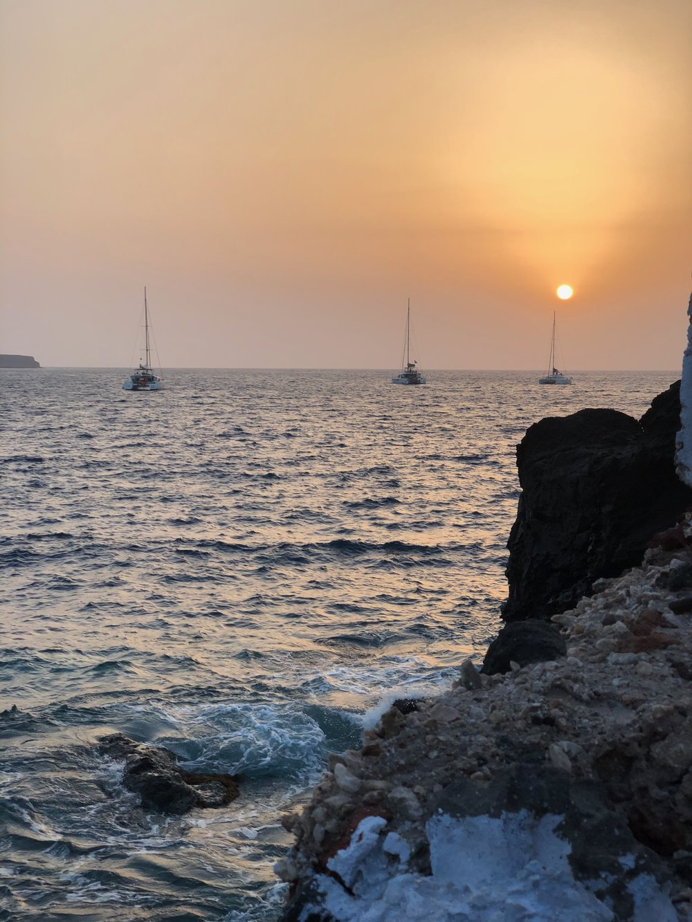 Sunset view from Amoudi Bay