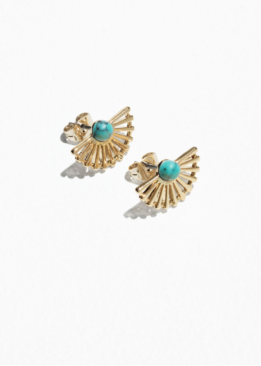 Sun Fan Stud Earrings - These elegant golden stud earrings with a turquoise stone are shaped like gracious sun fans. Aren't they pretty? Great for during the day, when you don't want to wear a set of long earrings. Oh they are also Nickel tested. Find them at and other stories here for only £17.