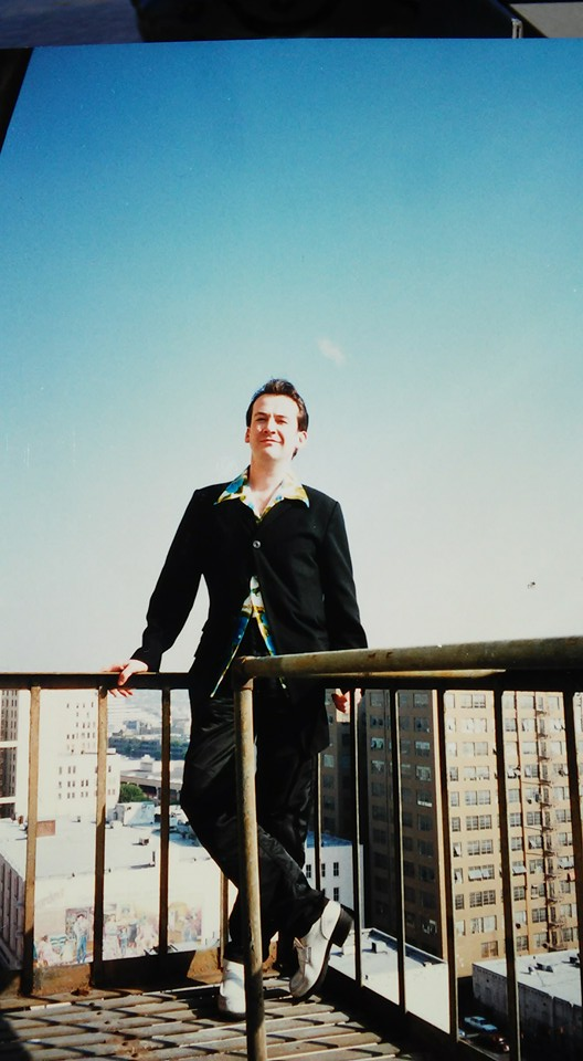 Hanging out on the fire escape downtown Los Angeles William B warehouse & design studio, wearing the first ever All Saints collection Nylon Blazer, black stretch cotton skinny jeans and White shoes - vintage Hawaiian shirt Back in 1995