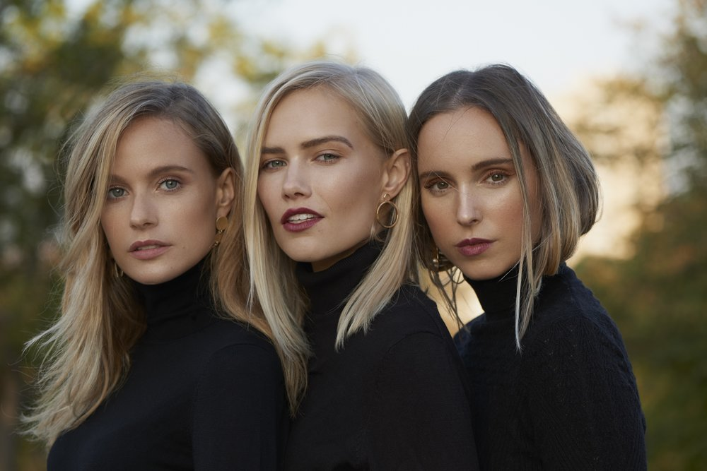 Three girls wearing turtle neck and red lips