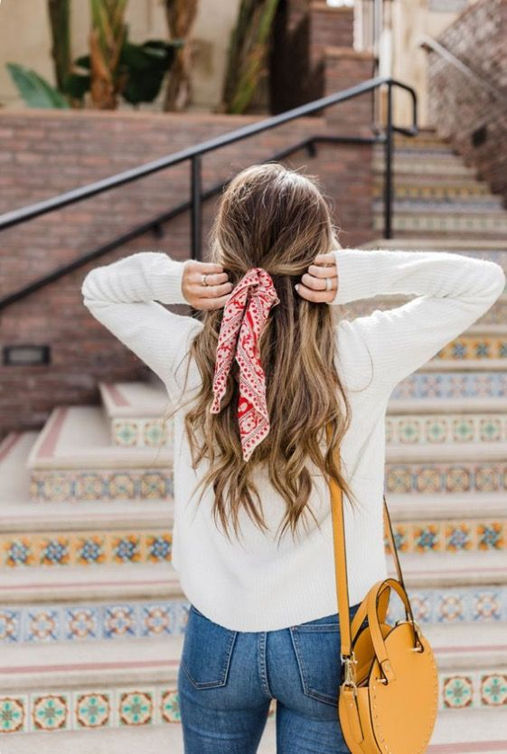THE HALF UP - Can't decide if you want to keep your hair up or down? Why not tie half of it up using a normal hair bubble, and then cover it up by creating a knot around the hair tie using a cute little scarf like in this picture.Let the ends hang down or tie it into a little bow :)