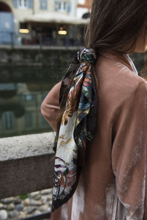 THE LOOSE PONY - If you've got quite long hair, then this is the look for you :)Put your hair into a super loose low ponytail, and tie your scarf around it letting the ends hang down alongside your hair.
