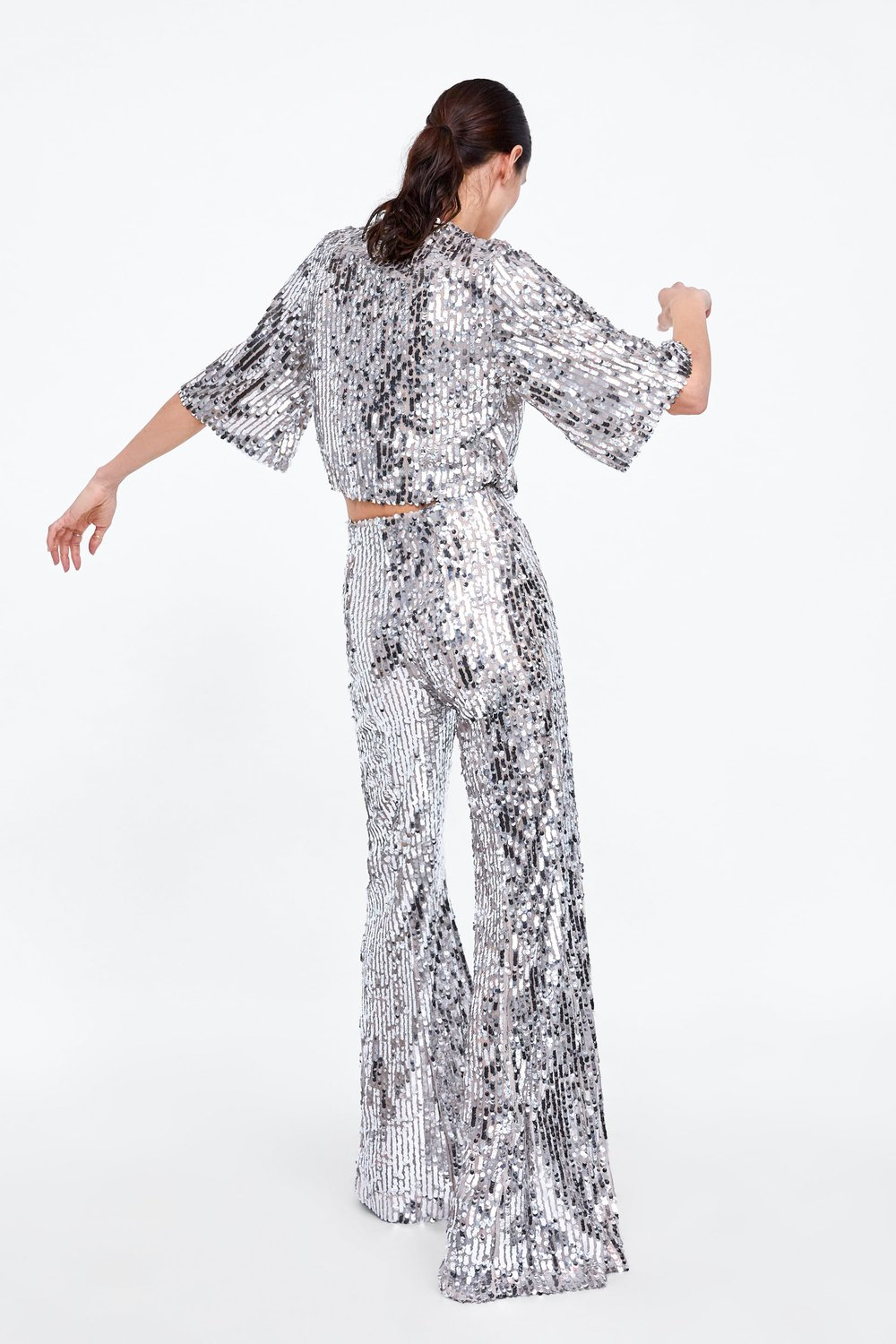 Sequin Set from Zara -  Shop the top here , and shop  flared the trousers here .