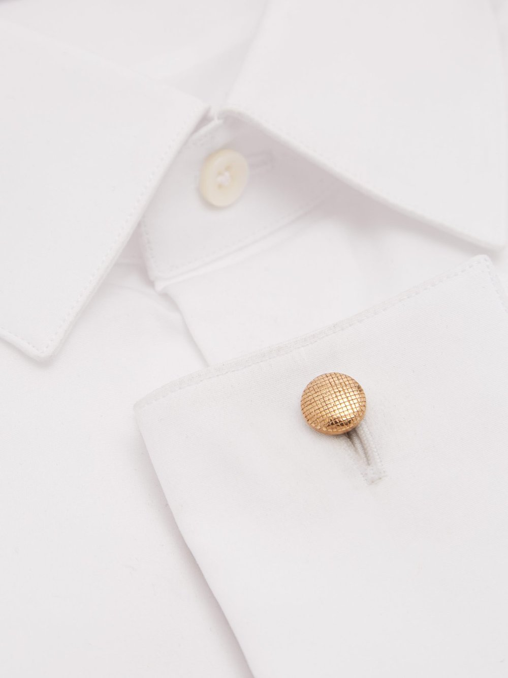 Bronze cufflinks - SAMUEL GASSMANN£167These beautiful cufflinks are embossed with a grid pattern symbolising the frame of a fabric. Clever isn't it! They are handmade in Paris and have the label's signature SG logo embossed on the bar. Buy them here