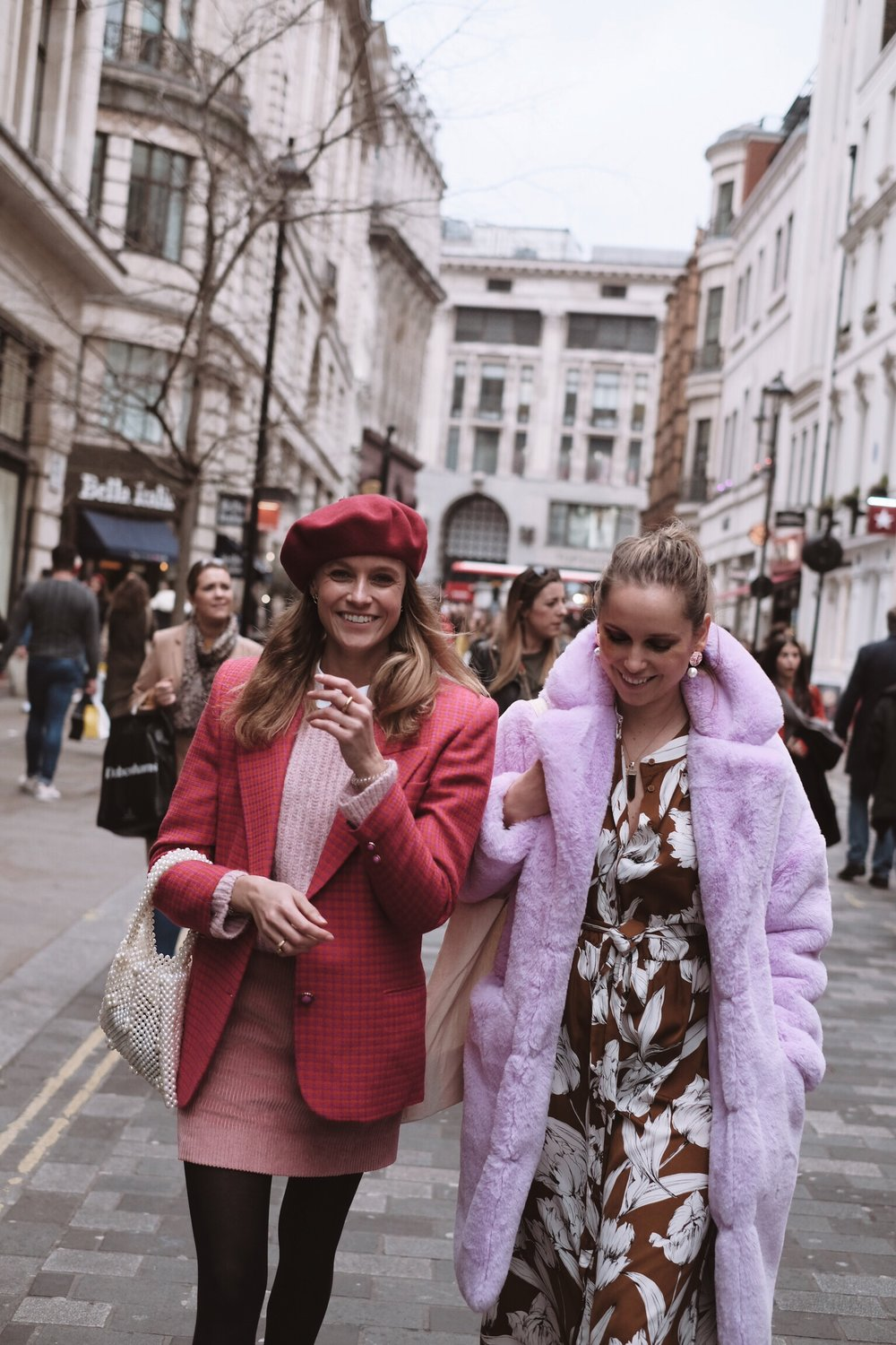 LOTS OF COLOUR! - Our first day at London Fashion Week was on Saturday the17th of February. We all decided to dress in quite colourful outfits.Annabell was mixing, vintage, high end and high street items, dressed head to toe in different shades of pink. Wearing a gorgeous vintage blazer and beret together with her maroon Balenciaga's. Her pink cord skirt and blouse is from COS and the pretty pearl handbag from Mango.Zsanett was rocking her lilac faux fur coat from Top Shop together with a floaty dress from Lindex and a selection of chunky jewellery pieces. To keep it more relaxed she paired the outfit with a classic pair of white Reebok trainers.Sara wore her brand new hand knitted jumper, from the Camilla Pihl design collection. Paired with wide-legged checkered trousers and a bright red puffer jacket to add some extra colour.