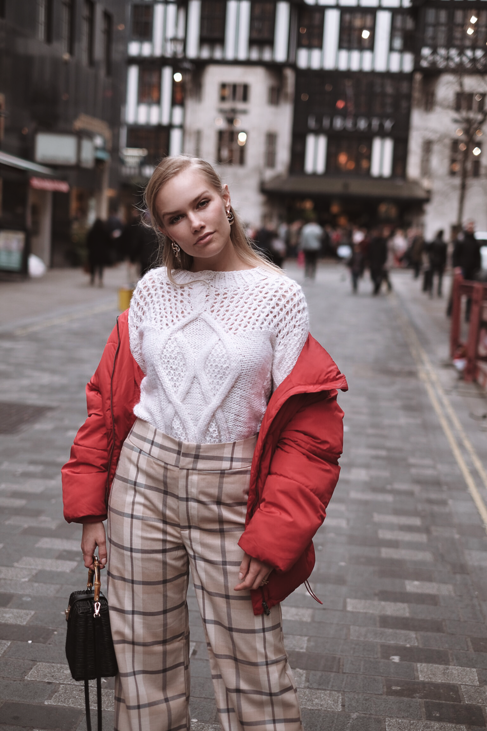 Sara is wearing:   Hand knitted wool jumper - designed by   Camilla Pihl Strikk (Knit)    Puffer Jacket - Cubus  Checkered trousers -   Lindex    Earrings and handbag -   Zara    Shoes -     Fila