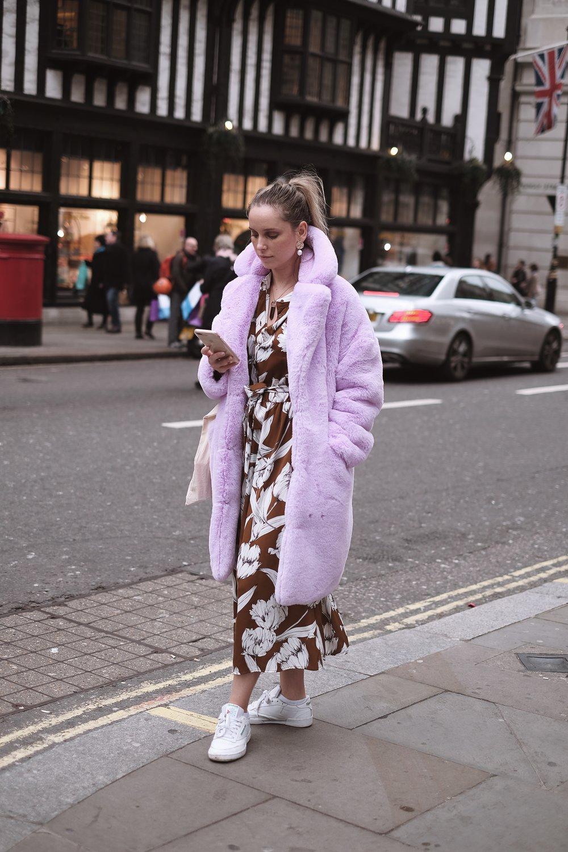 Zsanett is wearing:   Fux fur coat:   Top Shop    Dress:   Lindex    Shoes:   Reebok