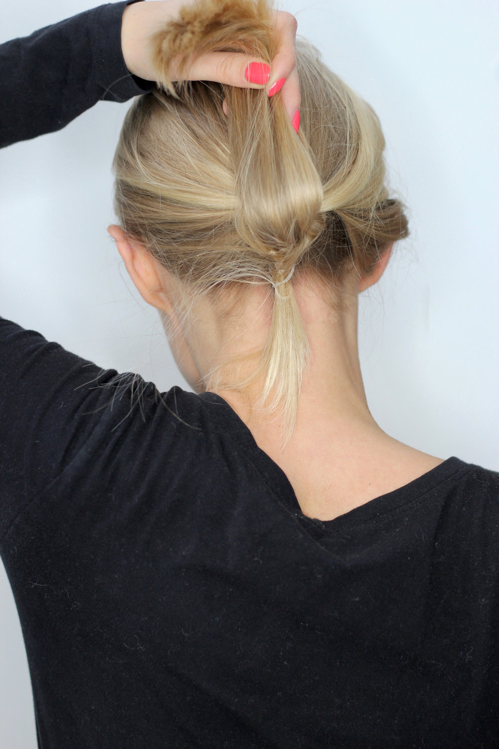 STEP 4 - Wrap the ends of the knot around the ponytail and tie it up with a small rubber hair tie beneath it.