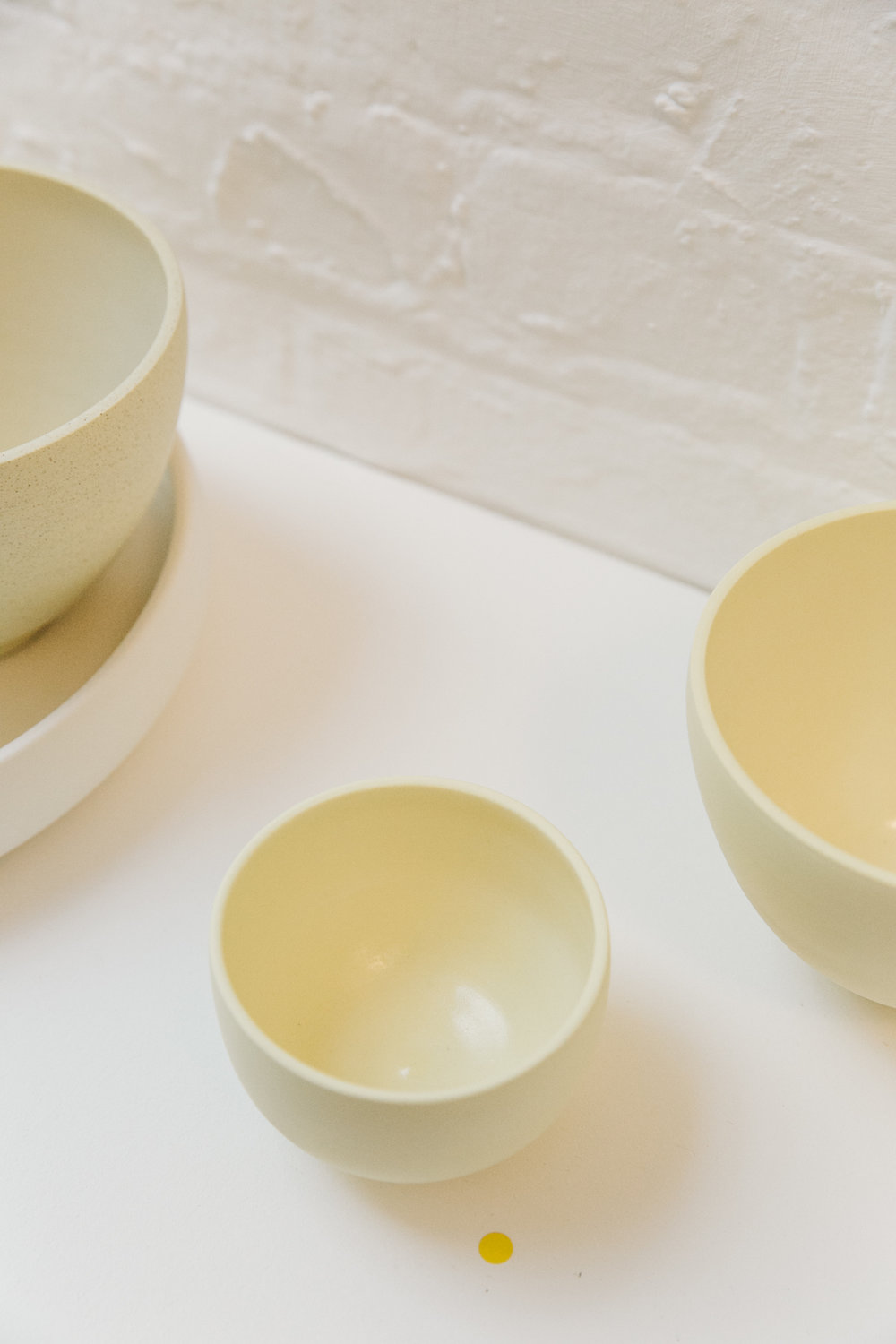 Luke Eastop's yellow ceramic bowls.