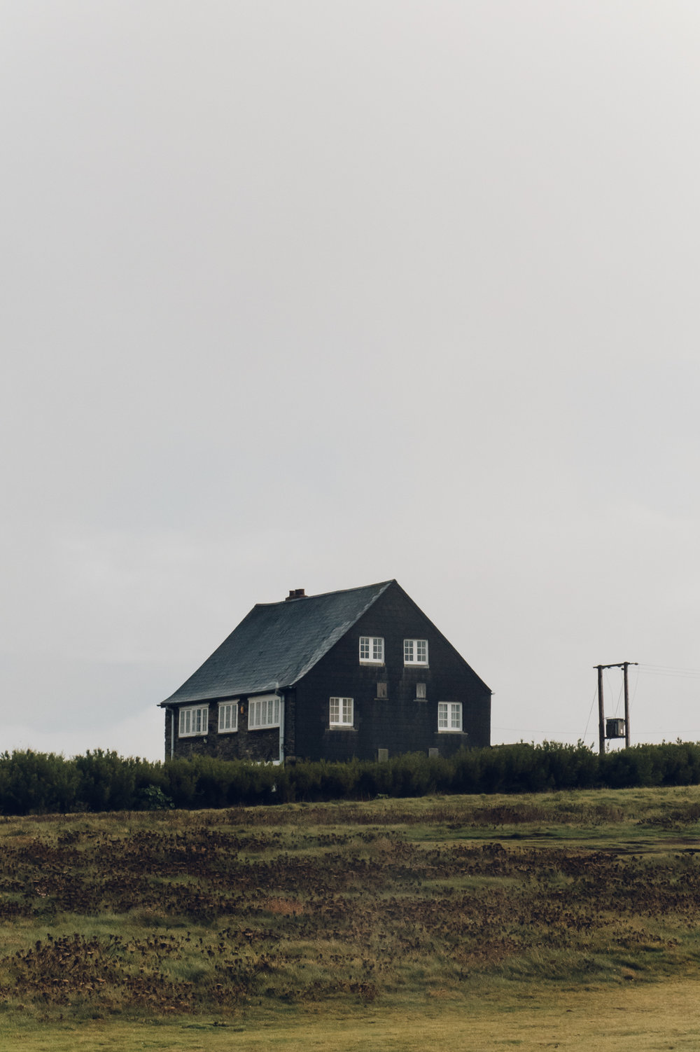A Scandinavian-inspired black house by the coast.