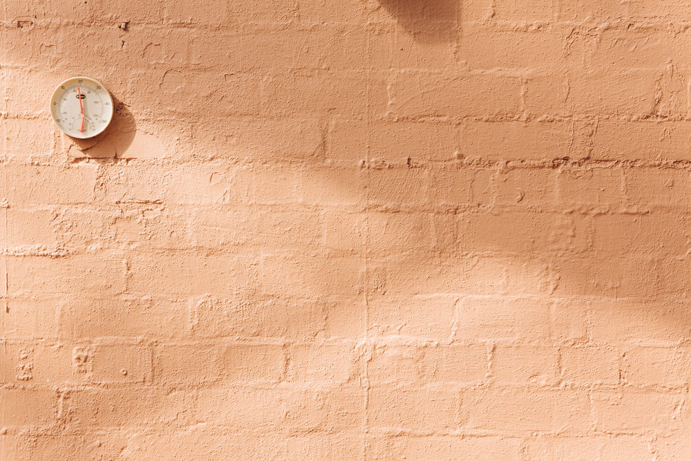 Peachy pink wall.